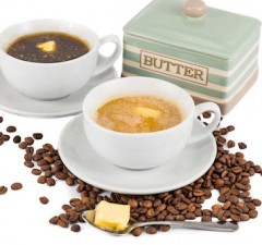 Two cups of coffee and butter, one black and one with milk
