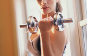 athletic woman lifting weights