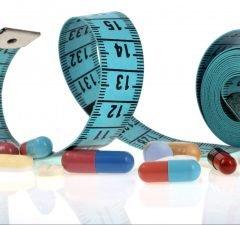 Maßband und L-Carnitin Tabletten zum abnehmen